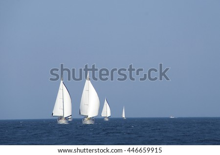 Regatta. Group of yachts under full sails at competitions in the Mediterranean Sea