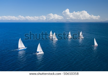 Regatta in indian ocean, sailboat and catamaran. Helicopter view - stock photo