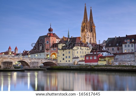Regensburg. Image of unesco heritage and historic bavarian city Regensburg with cathedral and old stone bridge over river Danube in Germany. - stock photo
