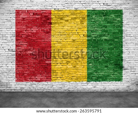 Reggae flag painted on white brick wall - stock photo