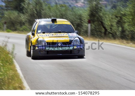 "REGGELLO, ITALY - SEPTEMBER 1: Renault Clio during the ""6th Rally of Reggello"" on September 1, 2013 in Reggello, Italy. ""Rally of Reggello"" is a rally held in Reggello."
