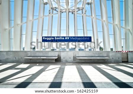 REGGIO EMILIA, ITALY - JUNE 20: view of Mediopadana High Speed Train Station on June 20, 2013 in Reggio Emilia, Italy. It is designed by architect Santiago Calatrava and composed of 457 steel frames. - stock photo