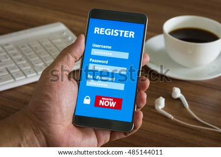 Register Membership Application on mobile smartphone on desk with dark background, Business Concept.