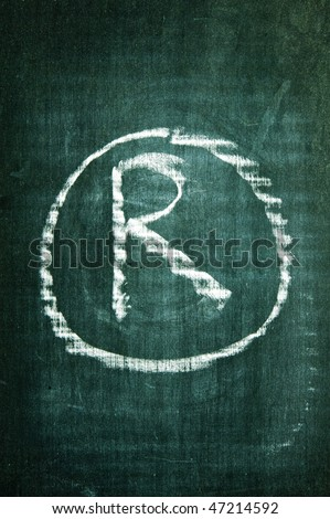 registered trademark symbol written with a chalk on a blackboard - stock photo