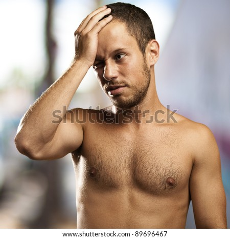 regret young man with a city as a background - stock photo