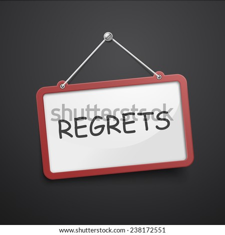 regrets hanging sign isolated on black wall - stock photo