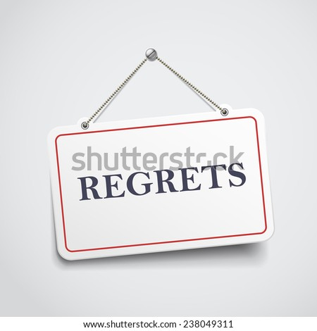 regrets hanging sign isolated on white wall  - stock photo
