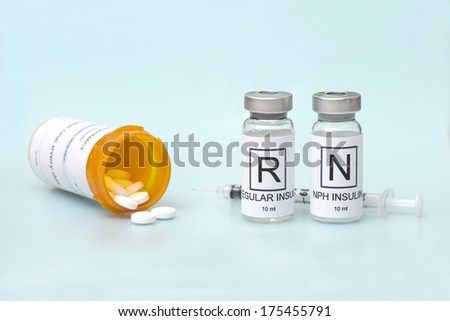 Regular and NPH insulin with syringe and diabetes medication on light blue background.