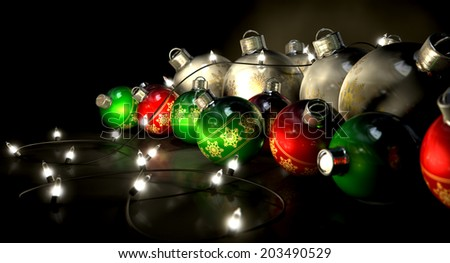 Regular green read and silver christmas baubles with a string of illuminated fairy lights draped over them on an isolated black background - stock photo