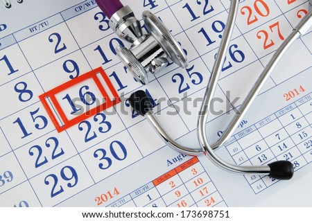 Regular medical examination concept, stethoscope on calendar - stock photo
