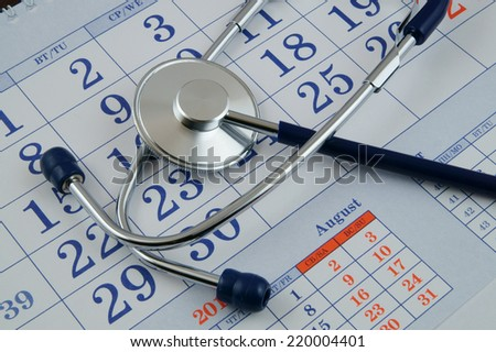 Regular medical examination concept, stethoscope on calendar