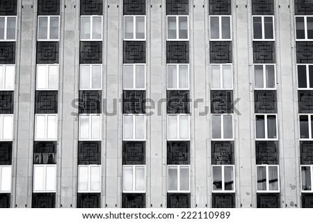 Regular structure of windows - modern building - stock photo