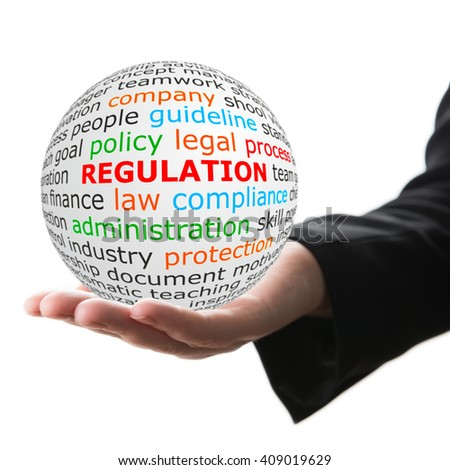 Regulation concept. Hand take white ball with red inscription regulation . - stock photo
