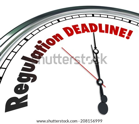 Regulation Deadline words on a white clock face reminding you it is time to meet, follow or comply with important rules, guidelines and laws - stock photo