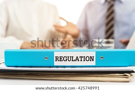Regulation, regulation documents file on desk in meeting room. Rules, Regulations Business Concept. - stock photo