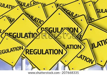 Regulation written on multiple road sign - stock photo