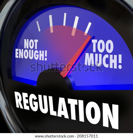 Regulations gauge measuring the amount of regulatory activity in an indsutry, with needle rising from not enough to too much - stock photo