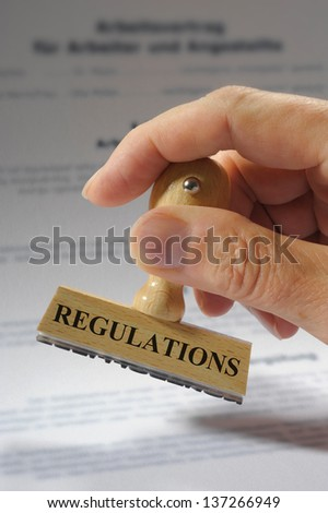 regulations marked on rubber stamp - stock photo