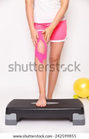 Rehab for injured leg with kinesio tape - stock photo