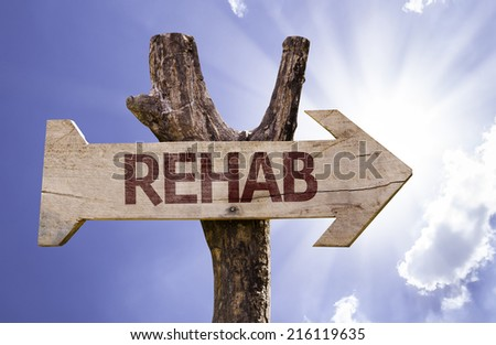 Rehab wooden sign on a beautiful day - stock photo