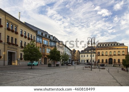 Reichenbach, Germany - August 27, 2015: Town hall, a fountain and other bulidings at the market place of Reichenbach (Vogtland)