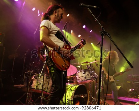 "REICHENBACH, GERMANY - JANUARY 14: Members of the rock group ""Golden Dawn"" performs in concert Reichenbach on January 14, 2012 in Wuerttemberg, Germany"