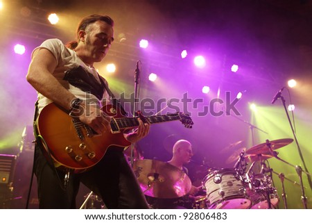 """REICHENBACH, GERMANY - JANUARY 14: Members of the rock group """"Golden Dawn"""" performs in concert Reichenbach on January 14, 2012 in Wuerttemberg, Germany - stock photo"""