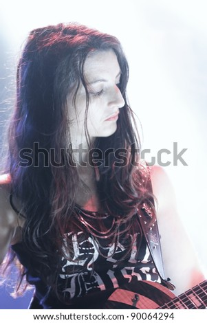 "REICHENBACH, GERMANY - NOVEMBER 26: Member Lady Verena Grifone of the rock group ""Black Thunder Ladies"" performs in concert Reichenbach on November 26, 2011 in Wuerttemberg, Germany"