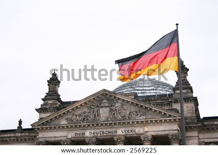 Reichstag - Berlin, Germany. Detail on the top of the building, with the Germany flag on the wind