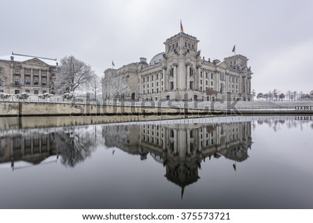 Reichstag building (Bundestag) and with reflection in river Spree in Winter, Berlin government district, Germany, Europe