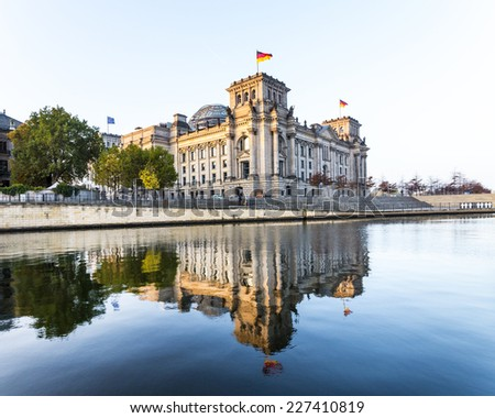 Reichstag (bundestag) with reflection in spree river in berlin, germany - stock photo