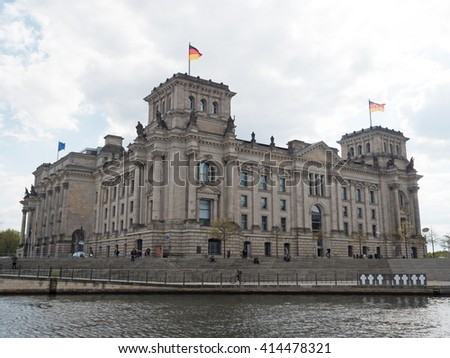 Reichstag in Berlin with the river Spree - stock photo