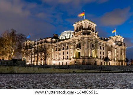 Reichtstag by night with frozen river Spree - stock photo