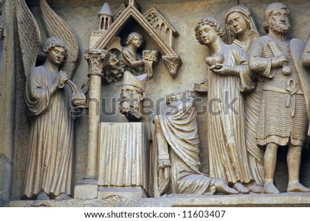 Reims (Champagne, France) - Statues of the Cathedral in gothic style - stock photo