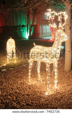 Reindeer lights in yard for christmas - stock photo
