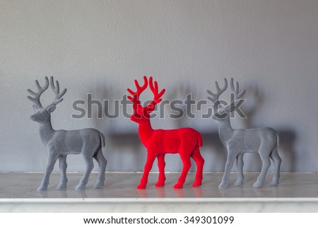 reindeer on the mantle piece - stock photo