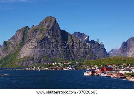 Reine - scenic fishing village on Lofoten Islands in summer - stock photo