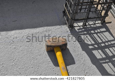 Reinforcing bar aka reinforcing steel or rebar for reinforced concrete structure and a hammer - stock photo