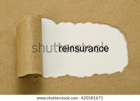 Reinsurance word written under torn paper. - stock photo