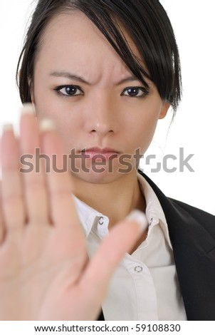 Reject gesture by Asian business woman with confident expression, closeup portrait on white background. - stock photo