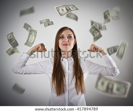 Rejoicing. Strong business woman concept. Girl in white and falling dollar banknotes. Success, currency and lottery concept.