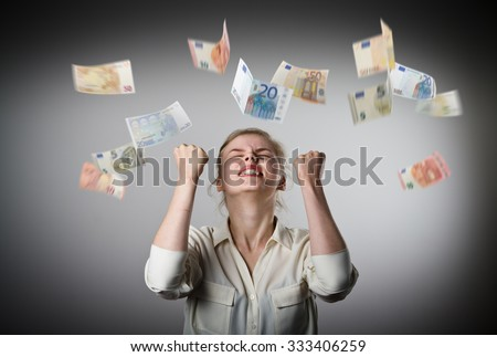 Rejoicing. Young slim woman and falling Euro banknotes. Success, currency and lottery concept. - stock photo