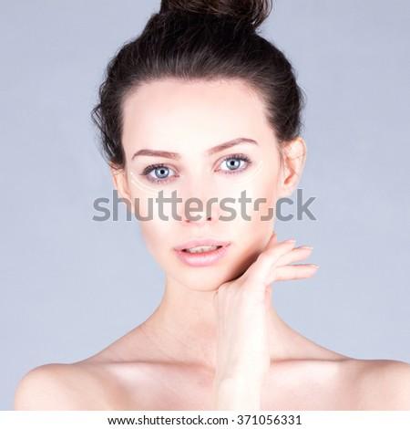 Rejuvenation program. Beautiful woman touching cheek. Result  facial. - stock photo