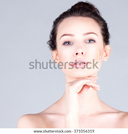 Rejuvenation program.  Portrait of beautiful woman with long neck touching chin. Lifting skin. - stock photo