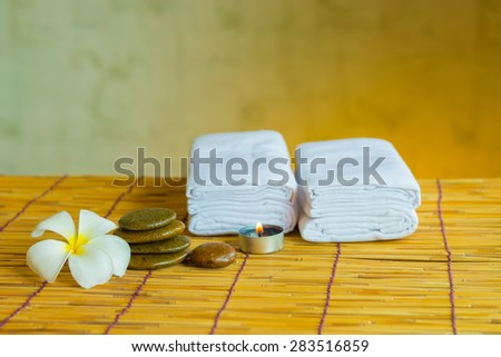 Relacing spa massage with a candle warm light. - stock photo