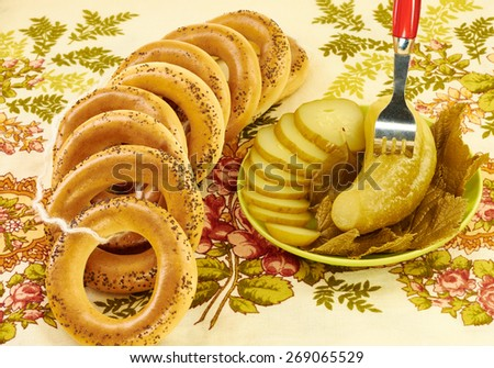 Related bagels with poppy seeds and pickled cucumbers - stock photo