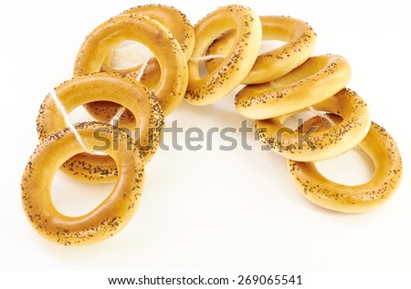 Related bagels with poppy seeds on a white background - stock photo