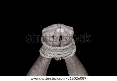 Related male hand rope on a black background - stock photo