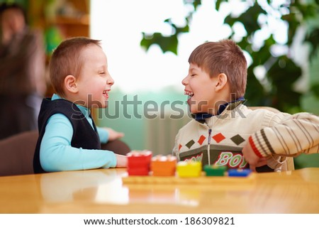 relation between kids with disabilities in preschool - stock photo