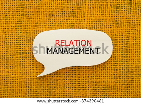 Relation Management written on bubble speech shape sticky note on burlap background - stock photo